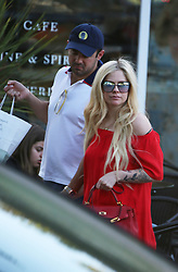 EXCLUSIVE: Avril Lavigne steps out with son of Texan billionaire Phillip Sarofim. The Canadian singer was spotted holding hands with her new boyfriend after shopping at Jayde's Market in Bel-Air. 22 Apr 2018 Pictured: Avril Lavigne, Phillip Sarofim. Photo credit: FIA / MEGA TheMegaAgency.com +1 888 505 6342