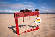 on the beach in Domburg on the peninsula Walcheren, hammer to rent for fixing the wind breaks, Zeeland, Netherlands.<br /> <br /> am Strand bei Domburg auf Walcheren, Verleih von Haemmern zum Befestigen der Windschutzsegel, Zeeland, Niederlande.