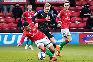 \a10\ battles for possession during the EFL Sky Bet League 2 match between Walsall and Tranmere Rovers at the Banks's Stadium, Walsall, England on 13 April 2021.