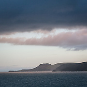 First light over Pen-y-Badell and the rounded hill of Pen Dinas Llochtyn which was occupied in the Iron Age around 500BC, Ceredigion.