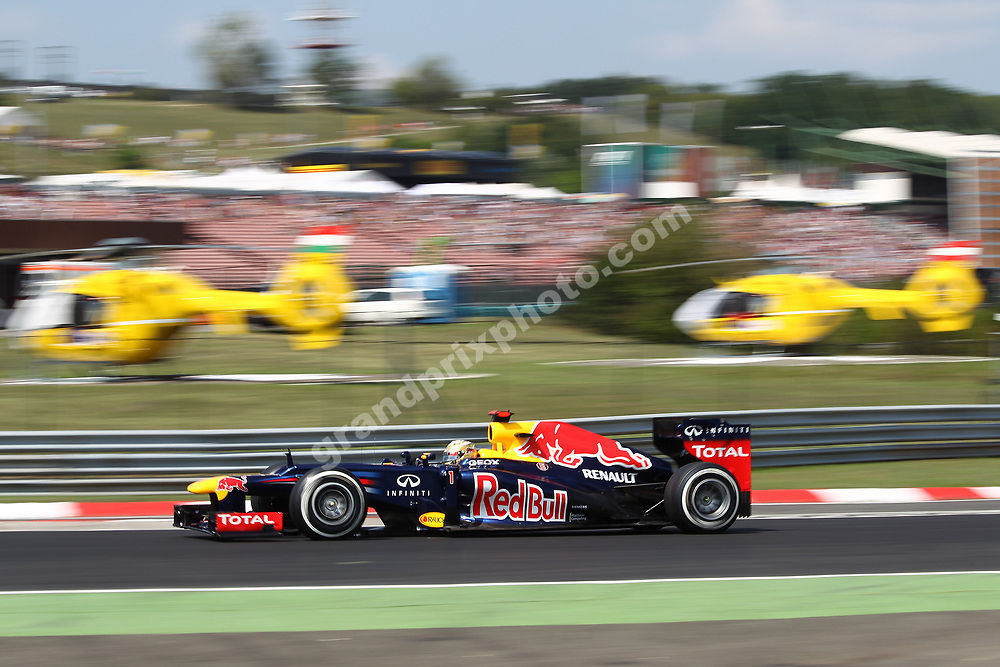 Sebastian Vettel (Red Bull-Renault) in front of rescue helicopters during practice for the 2012 Hungarian Grand Prix at the Hungaroring outside Budapest. Photo: Grand Prix Photo