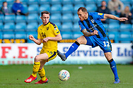 Oxford United forward Gavin Whyte (16) and Gillingham FC defender Barry Fuller (12)  during the EFL Sky Bet League 1 match between Gillingham and Oxford United at the MEMS Priestfield Stadium, Gillingham, England on 9 March 2019.