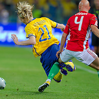 Hungary's Jozsef Varga (R) fights for the ball with Sweden's Christian Wilhelmsson (L) during the UEFA EURO 2012 Group E qualifier Hungary playing against Sweden in Budapest, Hungary on September 02, 2011. ATTILA VOLGYI