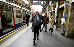 London Mayor Boris Johnson using the tube to get around while out campaigning in West London for the Mayoral Elections Thursday April 12, 2012. Photo By Andrew Parsons/i-Images
