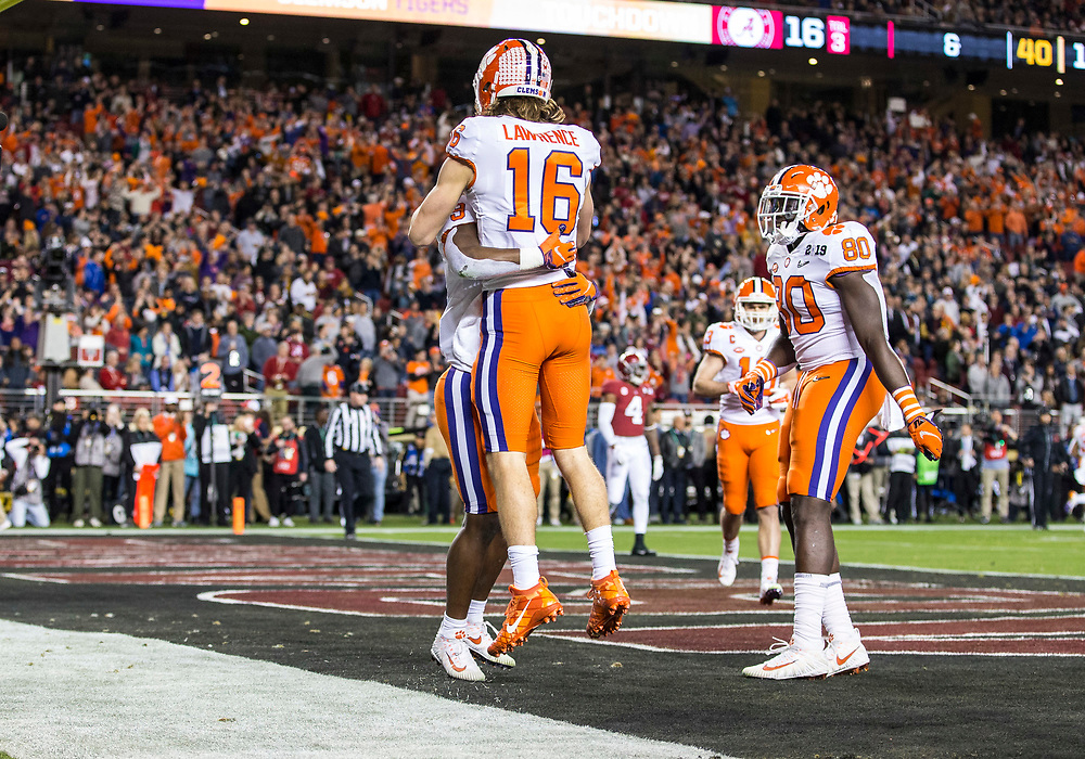 January 07, 2019:  Clemson running back Travis Etienne (9) and Clemson quarterback Trevor Lawrence (16) celebrate touchdown during College Football Playoff National Championship game action between the Clemson Tigers and Alabama Crimson Tide at Levi's Stadium in Santa Clara, California.  Clemson defeated Alabama 44-16.  John Mersits/CSM