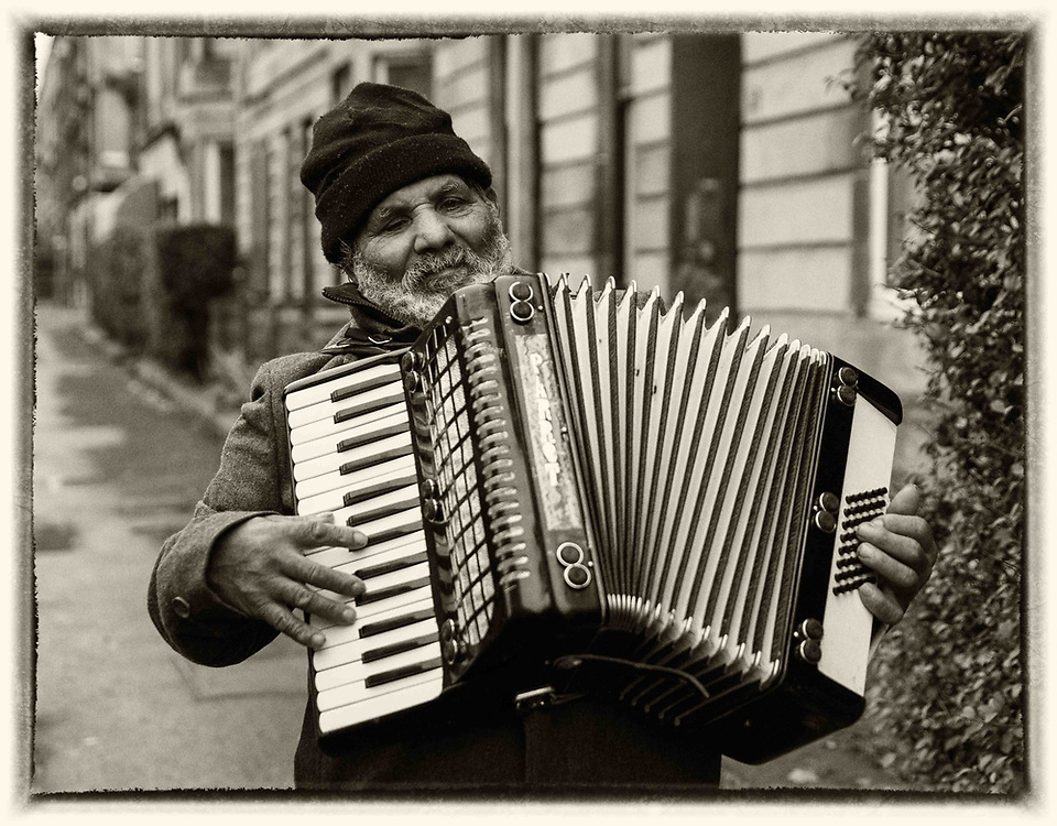 People of Govanhill, Glasgow.. An old man with an accordion walking along Annette Street. <br /> Picture Robert Perry for The Herald and  Evening Times 5th Dec 2016