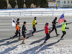 supporters run with Gary Allen as he runs 500 miles from Maine to the Super Bowl raising money for Wounded Warriors