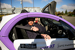 © London News Pictures. 11/10/2016. Milton Keynes, UK. A passenger doing up his seatbelt before a driverless car is tested around pedestrian areas in Milton Keynes in the first public test of autonomous electric vehicles in the UK. The vehicles have been developed by the Oxford Robotics Institute and Oxbotica. Photo credit: Ben Cawthra/LNP