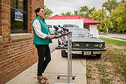 29 SEPTEMBER 2020 - DES MOINES, IOWA: THERESA GREENFIELD, Democratic candidate for the US Senate from Iowa, with her first husband's 1978 Chevy Nova at a press conference at IBEW offices in Des Moines. Her husband was a union electrician who died in an work place accident. She talked about her plan to help Iowa recover from the COVID-19 pandemic. The plan includes expanding COVID testing, better access to health care, directing more assistance to workers, and rebuilding the economy.      PHOTO BY JACK KURTZ