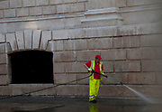 A worker deep cleaning the site. Cleared Occupy London OLSX site at St Paul's Cathedral in London, UK. On 27th February the Occupy anti-capitalist demonstration site was cleared and Tuesday morning was the paving stones for the first time since October 2011. The cleaned site now devoid of protesters starts to undergo a 3 day deep cleaning operation.