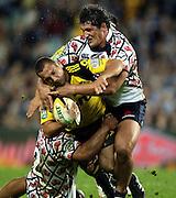 Aaron Cruden tackled by Jeremy Tilse and Tatafu Polota-Nau<br />Super 14 rugby union match, Waratahs vs Hurricanes, Sydney, Australia. <br />Saturday 14 May 2010. Photo: Paul Seiser/PHOTOSPORT