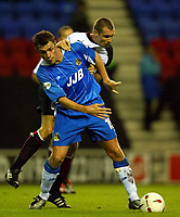 Photo. Aidan Ellis.<br />Wigan Athletic v Fulham.<br />Carling Cup 2nd Round.<br />23/09/2003.<br />Wigan's Geoff Horsfield and Fulham's Andy Melville