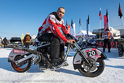 Sergey Batyrin on his Ural modified to be in-line with a snowmobile transmission and pull-start in the Baikal Mile Ice Speed Festival. Maksimiha, Siberia, Russia. Friday, February 28, 2020. Photography ©2020 Michael Lichter.