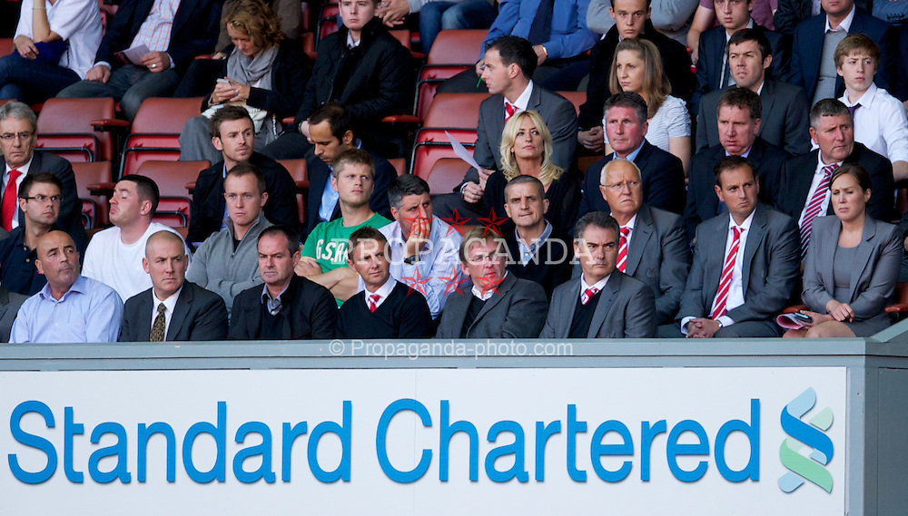 LIVERPOOL, ENGLAND - Wednesday, August 17, 2011: Liverpool's manager Kenny Dalglish, with academy technical manager Jose Segura and assistant manager Steve Clarke, watches his team's U19's in action against Sporting Clube de Portugal during the first NextGen Series Group 2 match at Anfield. (Pic by David Rawcliffe/Propaganda)
