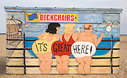 Painted deckchair hire shed with traditional seaside picture of people in swimming costumes, Great Yarmouth, Norfolk, England saying: 'It's Great Here!'