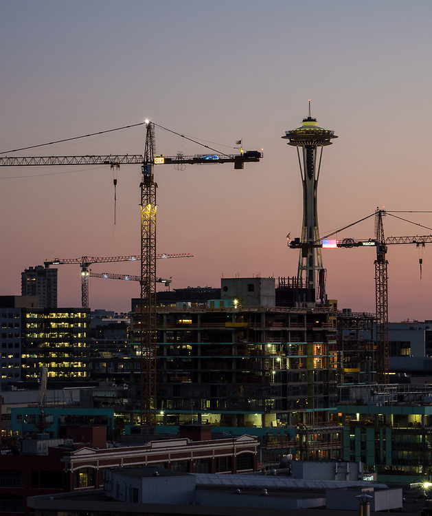 Construction cranes in Seattle, 07/24/2018, working in the South Lake Union neighborhood, in the vicinity where a crane fell Saturday 4/28/2019, killing four people. Crane arms display markings from GLY Construction and Morrow Equipment, two of the companies under investigation in the incident. Space Needle in the distance. 07/24/2018.  Unknown whether crane that fell is pictured.