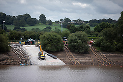 © Licensed to London News Pictures. 05/08/2019. Whaley Bridge, UK. High-capacity pumping pipes . The town of Whaley Bridge in Derbyshire remains evacuated after heavy rain caused damage to the Toddbrook Reservoir , threatening homes and businesses with flooding . Photo credit: Joel Goodman/LNP