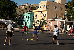 © Licensed to London News Pictures. 16/08/2020. Beirut, Lebanon. Children play football in the Karantina district of Beirut which has been badly destroyed following the huge explosion in Beirut Port on 4 August. Photo credit : Tom Nicholson/LNP