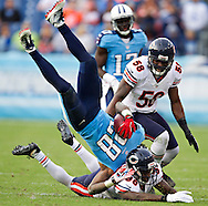 NASHVILLE, TN - NOVEMBER 4:  Chris Johnson #28 of the Tennessee Titans is tackled and is tripped upside down against the Chicago Bears at LP Field on November 4, 2012 in Nashville, Tennessee.  The Bears defeated the Titans 51-20.  (Photo by Wesley Hitt/Getty Images) *** Local Caption *** Chris Johnson Sports photography by Wesley Hitt photography with images from the NFL, NCAA and Arkansas Razorbacks.  Hitt photography in based in Fayetteville, Arkansas where he shoots Commercial Photography, Editorial Photography, Advertising Photography, Stock Photography and People Photography