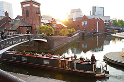 © Licensed to London News Pictures. 13/09/2016. Birmingham, West Midlands,  UK. Canal boats are seen in the early morning sunlight in Brindley Place. The day starts with clear skies and warm temperatures in Birmingham, West Midlands, UK. Temperatures of mid twenties deg centigrade are forecast today for Birmingham. Photo credit: Graham M. Lawrence/LNP