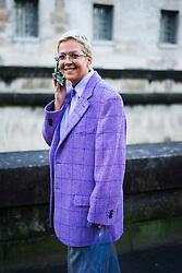 Ksenia Chilingarova wears glasses, a purple blazer jacket, flare pants, outside Valentino, during Paris Fashion Week Womenswear Fall/Winter 2018/2019, on March 4, 2018 in Paris, France.  (Photo by Nataliya Petrova/NurPhoto/Sipa USA)