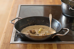 Close-up of cooking pasta soup on kitchen