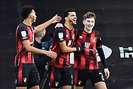Goal 1-0 - Dominic Solanke (9) of AFC Bournemouth celebrates scoring the opening goal with Lloyd Kelly (5) of AFC Bournemouth and David Brooks (7) of AFC Bournemouth during the EFL Sky Bet Championship match between Bournemouth and Huddersfield Town at the Vitality Stadium, Bournemouth, England on 12 December 2020.