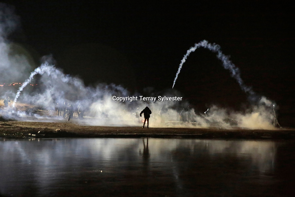 Police launch teargas canisters at opponents of the Dakota Access oil pipeline during a standoff on Backwater Bridge near the pipeline route on November 20, 2016. Cannon Ball, North Dakota, United States.