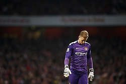 Man City Goalkeeper Joe Hart (ENG) holds looks dejected as he his head down after Arsenal Midfielder Mathieu Flamini (FRA) scores to level at 1-1 - Photo mandatory by-line: Rogan Thomson/JMP - 07966 386802 - 29/03/14 - SPORT - FOOTBALL - Emirates Stadium, London - Arsenal v Manchester City - Barclays Premier League.
