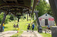 Riders easily hoist their bikes onto the chairlift as they take the ride to the summit at Highland Mountain Bike Park in Northfield.  (Karen Bobotas Photographer)