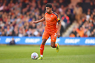 Luton Town player James Justin moves the ball downfield in the first half during the EFL Sky Bet League 1 match between Luton Town and AFC Wimbledon at Kenilworth Road, Luton, England on 23 April 2019.