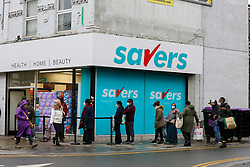© Licensed to London News Pictures. 01/11/2020. London, UK. Shoppers queuing outside Savers in north London, as panic buying continues. This is following the announcement of the second lockdown in England from Thursday 5 November until Wednesday 2 December,  as coronavirus cases are increasing. Minister for the Cabinet Office, Michael Gove, has said that the four-week shut-down could be extended into December if needed. Photo credit: Dinendra Haria/LNP