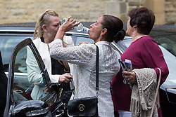 "© Licensed to London News Pictures . 28/08/2015 . Salford , UK . Mourners outside the church after the service . The funeral of Paul Massey at St Paul's CE Church in Salford . Massey , known as Salford's "" Mr Big "" , was shot dead at his home in Salford last month . Photo credit : Joel Goodman/LNP"