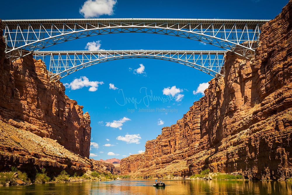 Navajo Bridge crosses the Colorado River's Marble Canyon near Lee's Ferry in the US state of Arizona. Apart from the Glen Canyon Bridge a few miles upstream at Page, Arizona, it is the only roadway crossing of the river and the Grand Canyon for nearly 600 miles (970 km). Spanning Marble Canyon, the bridge carries northbound travelers to southern Utah and to the Arizona Strip, the otherwise inaccessible portion of Arizona north of the Colorado River, which includes the North Rim of Grand Canyon National Park.<br /> Prior to the construction of the first Navajo Bridge, the only river crossing from Arizona to Utah was at nearby Lee's Ferry, where the canyon walls are low and getting vehicles onto the water is relatively convenient. The ferry offered only unreliable service, however, as adverse weather and flooding regularly prevented its operation.