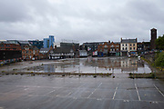 Empty car park in Digbeth in Birmingham city centre, which is virtually deserted under Coronavirus lockdown on a wet rainy afternoon on 28th April 2020 in Birmingham, England, United Kingdom. Britains second city has been in a state of redevelopment for some years now, but with many outdated architectural remnants still remaining, on a grey day, the urban landscape appears as if frozen in time. Coronavirus or Covid-19 is a new respiratory illness that has not previously been seen in humans. While much or Europe has been placed into lockdown, the UK government has put in place more stringent rules as part of their long term strategy, and in particular social distancing.