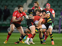 Rugby Union - 2020 / 2021 ER Challenge Cup - Quarter-final - Northampton Saints vs Ulster - Franklin Gardens<br /> <br /> Ulster Rugby's James Hume is tackled by Northampton Saints' Teimana Harrison and Piers Francis<br /> <br /> COLORSPORT/ASHLEY WESTERN