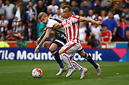 James McClean of West Bromwich Albion and Xherdan Shaqiri of Stoke City battle for the ball. Barclays Premier League match, Stoke city v West Bromwich Albion at the Britannia stadium in Stoke on Trent, Staffs on Saturday 29th August 2015.<br /> pic by Chris Stading, Andrew Orchard sports photography.