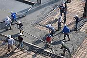 pouring of concrete floor on a large construction building site