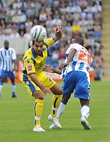 Photo: Tony Oudot/Richard Lane Photography.Colchester United v Leeds United. Coca Cola League One. 29/08/2009. <br /> Jason Crowe of Leeds is challenged by Colchesters Kevin Lisbie
