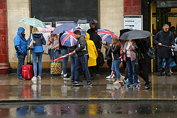 August 9, 2017 - London, London, United Kingdom - Image licensed to i-Images Picture Agency. 09/08/2017. London, United Kingdom. Tourists battle the wet weather in Camden Market, London. Picture by Dinendra Haria / i-Images (Credit Image: © Dinendra Haria/i-Images via ZUMA Press)