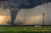 The first tornado of many churns through a field south of Dodge City, Kansas, May 24, 2016.