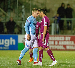 Forfar Athletic's Mark Hill  and Arbroath's Gavin Swankie have words after a tackle by Swankie. Forfar Athletic 2 v 3 Arbroath, Scottish Football League Division One played 8/12/2018 at Forfar Athletic's home ground, Station Park, Forfar.