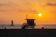 Watching sunset on Santa Monica Beach, California, USA