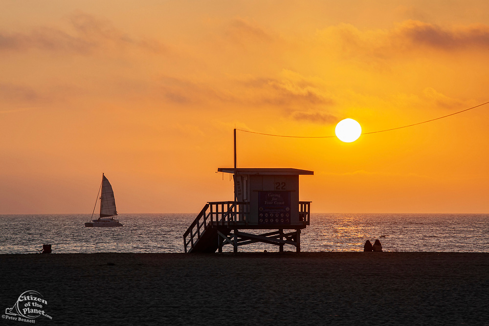 Watching sunset on Santa Monica Beach, California, USA