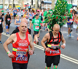 © Licensed to London News Pictures. 22/04/2018. London, UK.  Firemen who tackled the Grenfell Tower Fire running the 2018 London Marathon which is being run in unusually warm temperatures for April. This years event is being started by HRH Queen Elizabeth II. Photo credit: Tom Nicholson/LNP