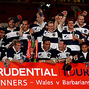 Barbarians' captain Pat Lam (c) celebrates with the cup after beating Wales