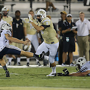 ORLANDO, FL - OCTOBER 09:  J.J. Worton #9 of the UCF Knights runs past punter Scott Arellano #23 of the Brigham Young Cougars at Bright House Networks Stadium on October 9, 2014 in Orlando, Florida. (Photo by Alex Menendez/Getty Images) *** Local Caption *** J.J. Worton; Scott Arellano