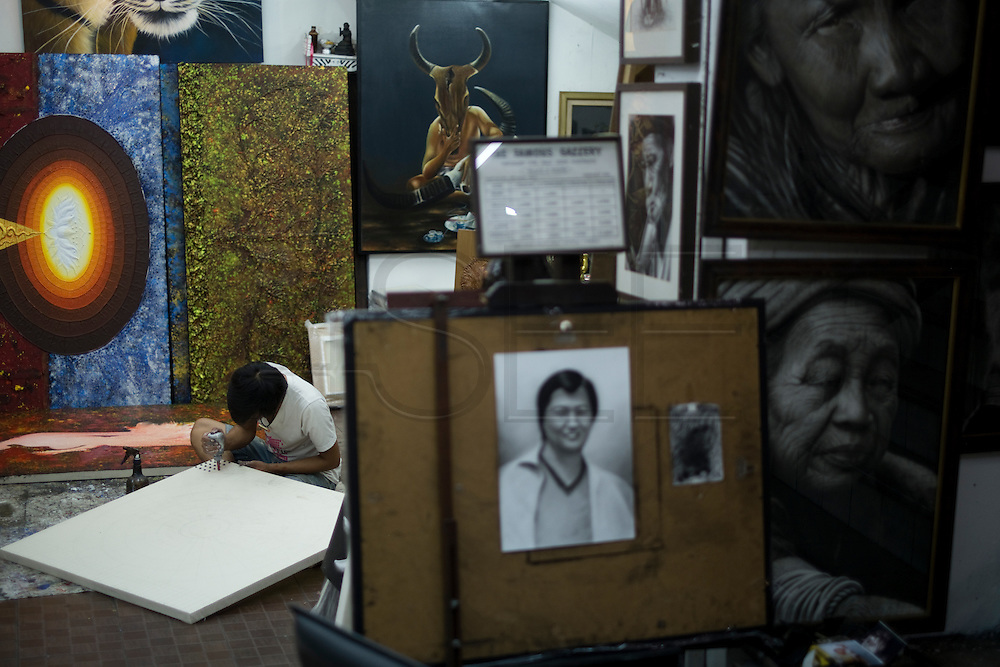 Artists create and copy paintings and photographs in Chiang Mai, Thailand. PHOTO TIAGO MIRANDA