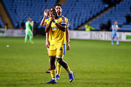 Wimbledon defender Adedeji Oshilaja (4) applauds the fans  during the EFL Sky Bet League 1 match between Coventry City and AFC Wimbledon at the Ricoh Arena, Coventry, England on 12 January 2019.