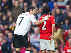 MANCHESTER, ENGLAND - Sunday, March 16, 2014: Liverpool's Luis Suarez and Manchester United's Rafael during the Premiership match at Old Trafford. (Pic by David Rawcliffe/Propaganda)MANCHESTER, ENGLAND - Sunday, March 16, 2014: Liverpool's Luis Suarez and Manchester United's Rafael during the Premiership match at Old Trafford. (Pic by David Rawcliffe/Propaganda)